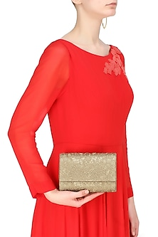 Gold floral lace flapover clutch by Inayat