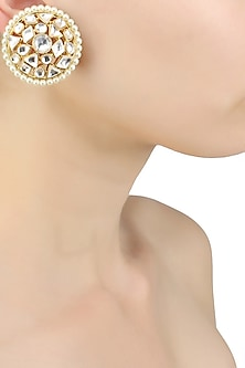 Gold finish uncut polki stud earrings by Just Shraddha
