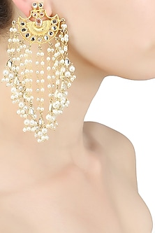 Gold finish uncut stone and kundan earrings with pearl tassel