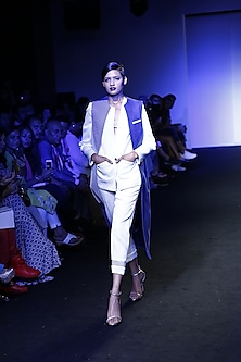 Electric blue honeycomb panelled slim vest by Kanika Goyal