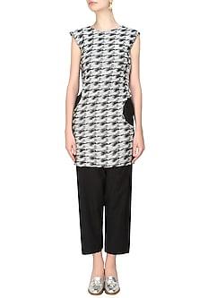 Black and ecru cutout sleeveless long top by Kapda By Urvashi Kaur