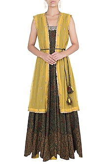 Green and yellow embroidered gown with jacket and belt by Khushbu Rathod