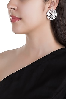 White Finish Spiral Earrings by Just Shraddha