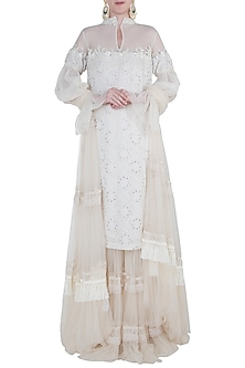 Ivory embroidered lehenga set by Kotwara by Meera and Muzaffar Ali