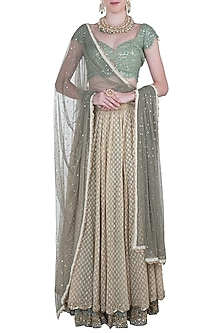 Teal and beige embroidered lehenga set by Kotwara by Meera and Muzaffar Ali