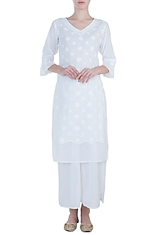 White chikankari kamdani kurta with pants by Kotwara by Meera and Muzaffar Ali