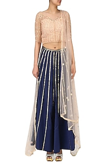 Nude peach and blue embroidered lehenga set by Kudi Pataka Designs