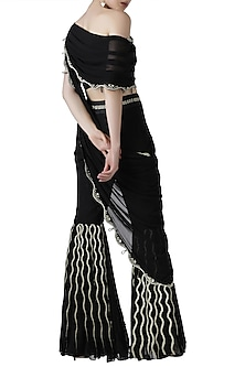 Black embroidered drape top with pleated pants