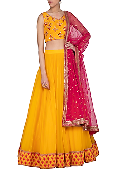 Yellow embroidered pleated lehenga set by Megha & Jigar