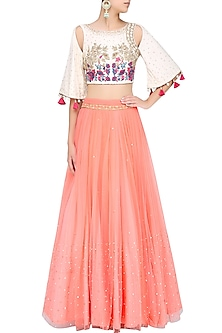 Ivory Shoulder Cut Out Embroidered Crop Top With Rose Pink Skirt by Monika Nidhii