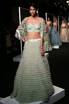 Sage Green Ruffled Lehenga with Embroidered Cape and Corset by Monika Nidhii