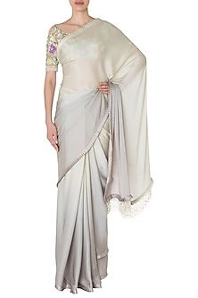 Grey and Sage Green Fringes Saree with Multi-Colored Embroidered Blouse. by Manish Malhotra