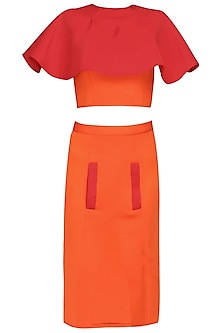 Orange and red color blocked cape top with high slit skirt by Manika Nanda