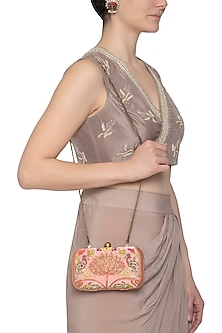 Peach embroidered clutch by MKNY
