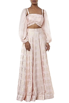 Pearl pink printed lehenga skirt with bustier and shrug by Masaba