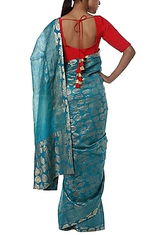 Teal blue printed banarasi saree with red blouse piece