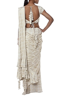 Ivory printed ruffle pleated saree with blouse piece