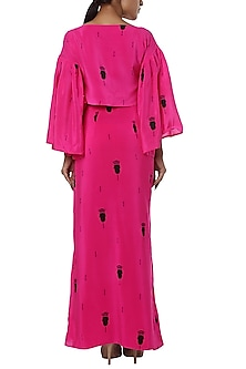 Pink printed wrap top with drape skirt by Masaba