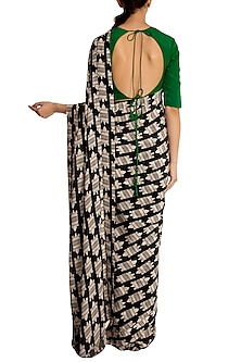 Black and white printed saree with green blouse piece
