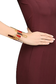 Gold Plated Red and Maroon Satin Glass Stones Rectangular Motif Bracelet by Malvika Vaswani