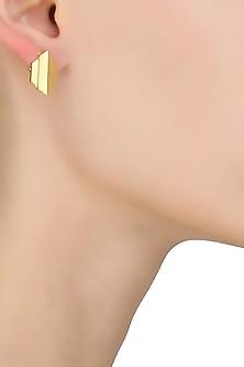 Gold plated capsule arrow stud earrings by Malvika Vaswani