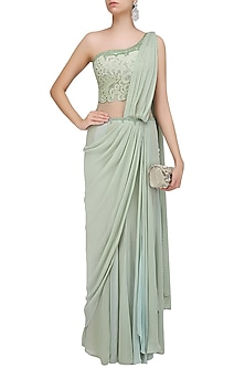 Pastel Green Mukaish Embroidered One Shoulder Drape Saree by Mandira Wirk