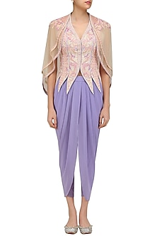 Ivory Flora Conical Jacket with Double Layered Cape and Lilac Dhoti Pants by Mandira Wirk