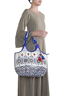 White & Blue Handblock Printed Embroidered Tasseled Hobo Bag by Neonia