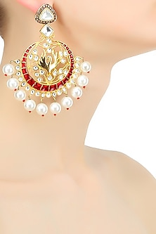 Gold plated red flying swan kundan and pearls earrings by Nepra By Neha Goel