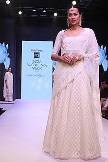 Ivory Floral Embroidered Blouse and Lehenga Skirt Set by Niki Mahajan