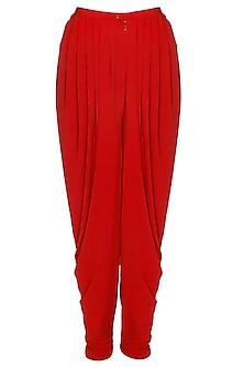 Red pleated jersey dhoti pants by Namrata Joshipura