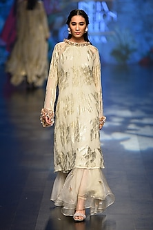Off white palm leaf asymmetrical tunic with organza pleated skirt by Nikasha