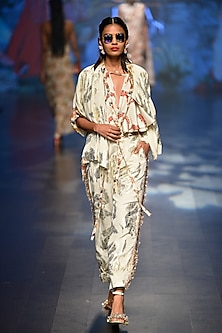 Off white foil printed jacket with scalp flared top and high waisted pants by Nikasha