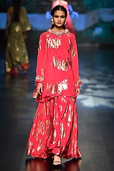Jamuni foil printed asymmetrical tunic with jamuni palm leaf pleated skirt by Nikasha