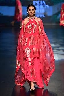 Jamuni bibi badal pleated halter neck tunic with pleated skirt and cape by Nikasha