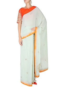 Mint Embroidered Motif Saree with Contrast Red Embellished Blouse by Nikasha