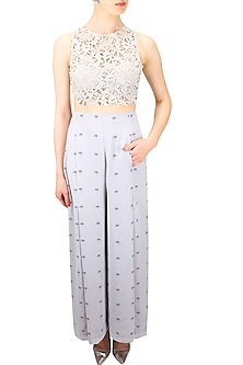 Light grey lantana printed high waisted palazzo pants by Nishka Lulla