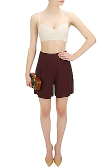 Marsala red high waisted shorts by Nishka Lulla