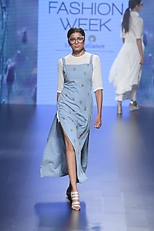White fitted mesh dress and blue denim dungaree masi dress by Nishka Lulla