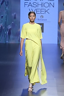 Yellow cube asymmetric crop top and palazzo pants by Nishka Lulla