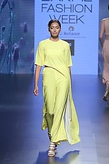 Yellow cube asymmetric crop top and palazzo pants by Nishka Lulla