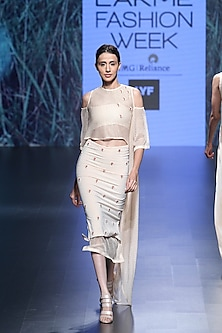 Gold mesh cold shoulder beaded crop top and skirt by Nishka Lulla