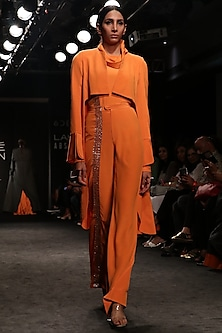 Tangerine High Low Coat with Turtle Neck Body Suit and Bell Bottom Pants