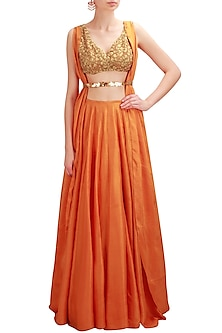 Mango color embroidered cowl back lehenga set by Nikhil Thampi