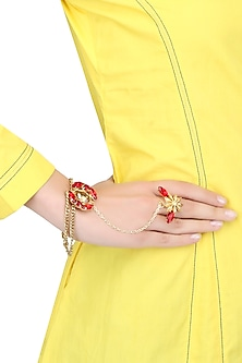 Gold plated double layered hand harness with red and gold stones