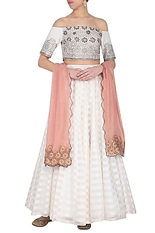 Off white embroidered lehenga set by POULI