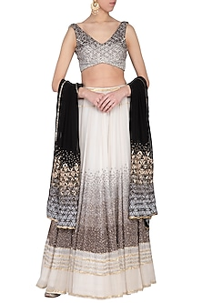 Off white ombre embroidered lehenga set by POULI