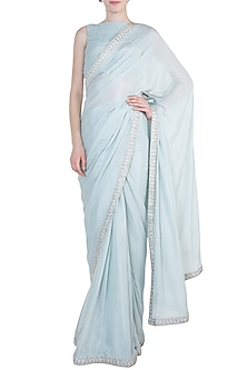Dull blue embroidered saree set by PINK PEACOCK COUTURE