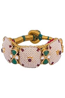 Gold plated pearl, stones, zari and kundan pochi bracelet by Parure