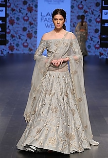 Powder blue off shoulder blosue with powder blue pleated lehenga and embroidered dupatta by Payal Singhal